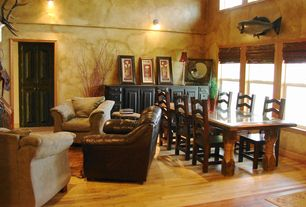 Eclectic Dining Room with Built-in bookshelf, Hardwood floors, Wall sconce, High ceiling