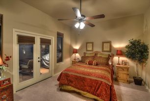 Mediterranean Guest Bedroom with French doors, Carpet, double-hung window, Ceiling fan, Standard height