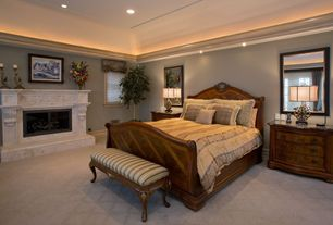 Traditional Master Bedroom with Cove lighting, Roman shades, Carpet, Crown molding, stone fireplace