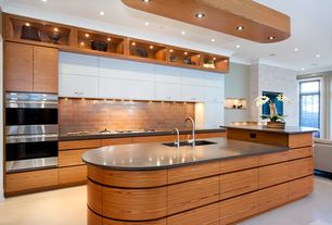 Contemporary Kitchen with Soapstone counters, Undermount sink, L-shaped, European Cabinets, Kitchen island, Crown molding