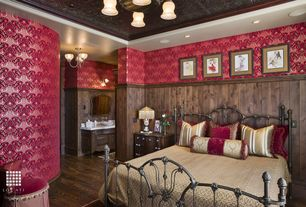 Country Guest Bedroom with Chandelier, Hardwood floors, interior wallpaper, Crown molding