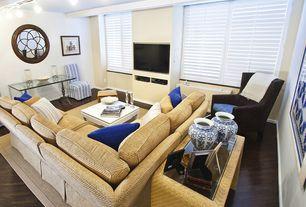 Modern Living Room with Standard height, Hardwood floors, Built-in bookshelf, can lights, Casement