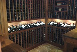 Traditional Wine Cellar with Built-in bookshelf, travertine floors
