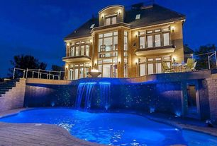 Traditional Swimming Pool with Pathway, Fire pit, Fountain, exterior stone floors, French doors, Transom window