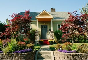 Traditional Front Door with Fence, Pathway, Glass panel door, Raised beds, exterior stone floors