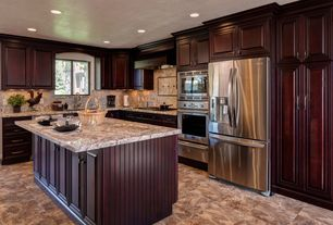 Traditional Kitchen with Complex granite counters, Flat panel cabinets, Kitchen island, Arizona tile emperador light