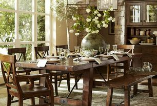 Rustic Dining Room with Pendant light, Built-in bookshelf, picture window, Standard height, Hardwood floors