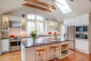 Traditional Kitchen with L-shaped, Granite solid surface countertop in deep espresso, European Cabinets, Pendant light, Flush