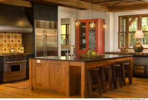 Contemporary Kitchen with Kitchen island, Flat panel cabinets, Breakfast bar, Talavera tile, L-shaped, Soapstone counters