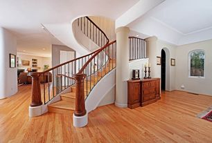 Entryway with Hardwood floors, Columns, Standard height, can lights, curved staircase