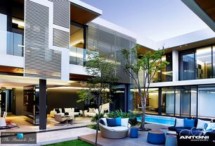 Contemporary Patio with Lap pool, picture window, Pathway, exterior stone floors, Deck Railing, sliding glass door