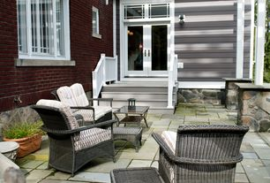 Traditional Patio with French doors, Transom window, exterior stone floors
