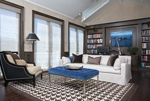 Traditional Living Room with Built-in bookshelf, Cathedral ceiling, French doors, Hardwood floors, Balcony