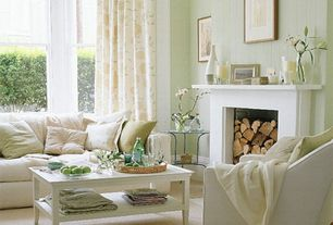 Cottage Living Room with Fireplace, double-hung window, Standard height, Cement fireplace, Carpet