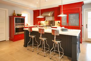 Eclectic Kitchen with Casement, double wall oven, porcelain tile floors, Inset cabinets, Breakfast bar, electric cooktop