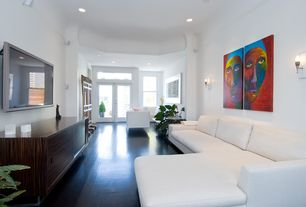 Contemporary Living Room with Hardwood floors, Standard height, Wall sconce, can lights