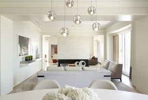 Contemporary Great Room with Pendant light, picture window, stone fireplace, can lights, Standard height, Laminate floors