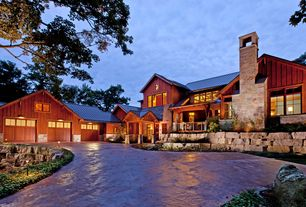 Country Exterior of Home with Cedar siding, Lake michigan, Exterior accent lighting, Metal roof, Fond Du Lac Rustic Stone