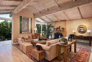 Mediterranean Living Room with flush light, Fireplace, picture window, Exposed beam ceiling, Paint 1, sliding glass door