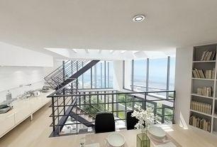 Contemporary Dining Room with Laminate floors, Skylight, Built-in bookshelf