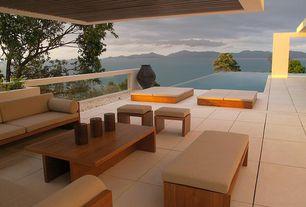 Modern Patio with exterior tile floors, exterior concrete tile floors, Deck Railing, Infinity pool