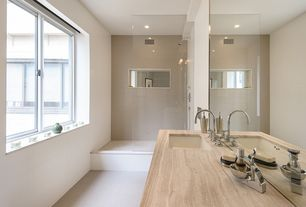 Contemporary 3/4 Bathroom with frameless showerdoor, Sandstone counters, Pental - Saturnia Polished Travertine Slab