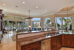 Traditional Kitchen with Stone Tile, Crown molding, flush light, Breakfast nook, Flush, Arched window, Limestone Tile