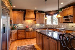 Country Kitchen with Simple granite counters, Built In Refrigerator, Undermount sink, full backsplash, electric cooktop