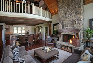 Craftsman Great Room with Cathedral ceiling, double-hung window, Loft, Fireplace, Pendant light, stone fireplace, flush light