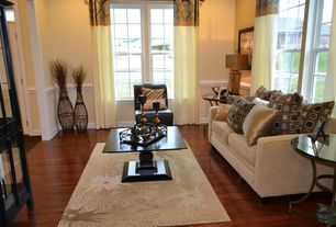 Traditional Living Room with Hardwood floors, Built-in bookshelf, double-hung window, Chair rail, Standard height