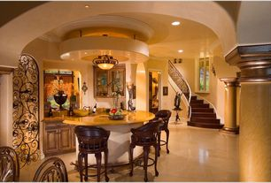 Mediterranean Bar with stone tile floors, Casement, can lights, flush light, Crown molding, specialty door, High ceiling