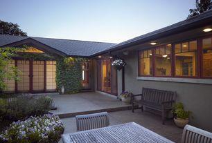 Contemporary Patio with Vertical garden, Paint, Recessed lighting, Casement, Weathered teak bench, Living wall