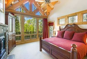 Rustic Master Bedroom with Fireplace, Casement, Carpet, picture window, Paint, stone fireplace, Built-in bookshelf
