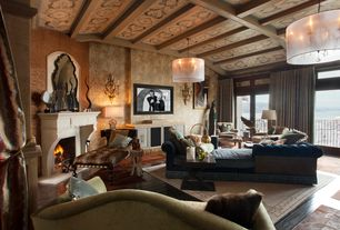 Eclectic Living Room with Chandelier, Wall sconce, Transom window, stone fireplace, specialty door, Exposed beam