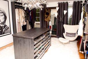 Eclectic Closet with Casement, Standard height, Hardwood floors, Built-in bookshelf, Chandelier