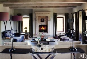 Contemporary Living Room with stone fireplace, Hardwood floors, Exposed beam
