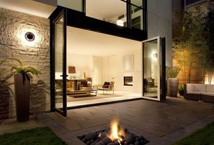 Modern Patio with French doors, exterior stone floors, Fence, Fire pit