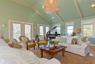 Tropical Living Room with French doors, High ceiling, Chandelier, Exposed beam, Hampton slipcovered sofa, Hardwood floors