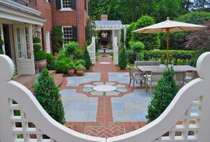 Traditional Patio with exterior stone floors, Gate, Pathway, Fence, Glass panel door, Bird bath, Trellis