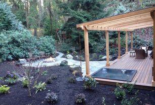 Cottage Landscape/Yard with Pathway, exterior stone floors, Trellis, Fire pit