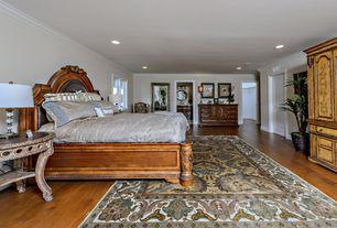 Mediterranean Master Bedroom with specialty door, Hardwood floors, Crown molding