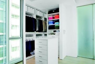 Contemporary Closet with Built-in bookshelf, Laminate floors