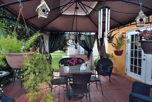 Traditional Porch with French doors, Gazebo over deck, Fence, stucco siding, Hanging plants, Wrap around porch