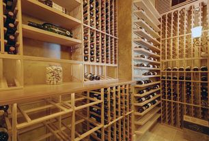 Modern Wine Cellar with limestone tile floors, High ceiling, Wall sconce, stone tile floors