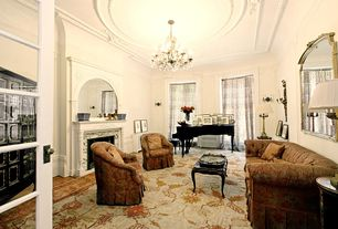 Traditional Living Room with Fireplace, Chandelier, Cement fireplace, Crown molding, Carpet, High ceiling, specialty window