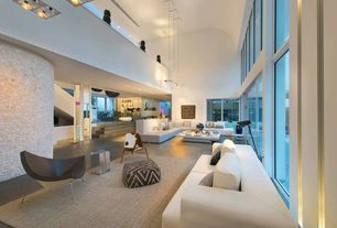 Modern Great Room with sliding glass door, Sunken living room, Cathedral ceiling, flush light, can lights, picture window