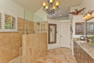 Traditional Master Bathroom with Handheld showerhead, Raised panel, Arched window, Built-in bookshelf, Chandelier, Flush