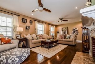 Traditional Living Room with stone fireplace, double-hung window, Hardwood floors, can lights, Fireplace, Standard height