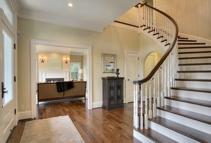 Traditional Entryway with double-hung window, flat door, can lights, Glass panel door, Hardwood floors, Crown molding
