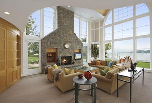 Modern Living Room with stone fireplace, Arched window, Built-in bookshelf, Transom window, Cathedral ceiling, Carpet